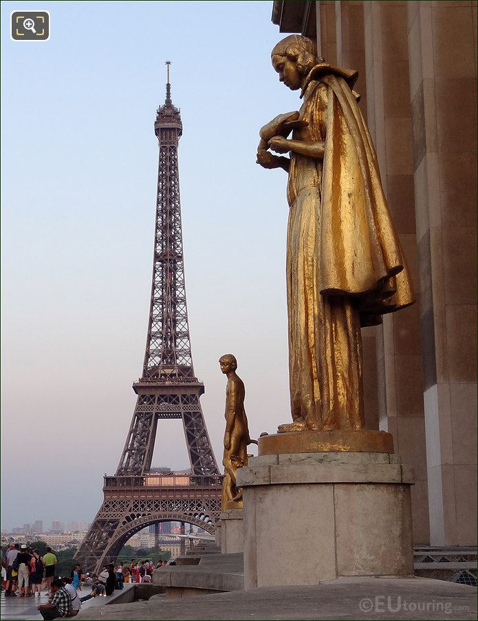 Eiffel Tower With Golden Statues