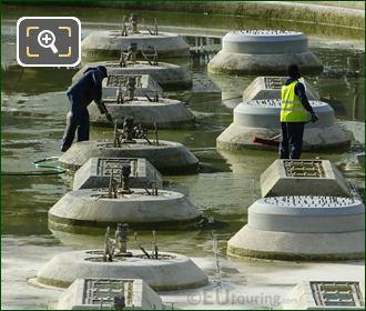 Workers Cleaning Water Fountains Inside Jardins Du Trocadero
