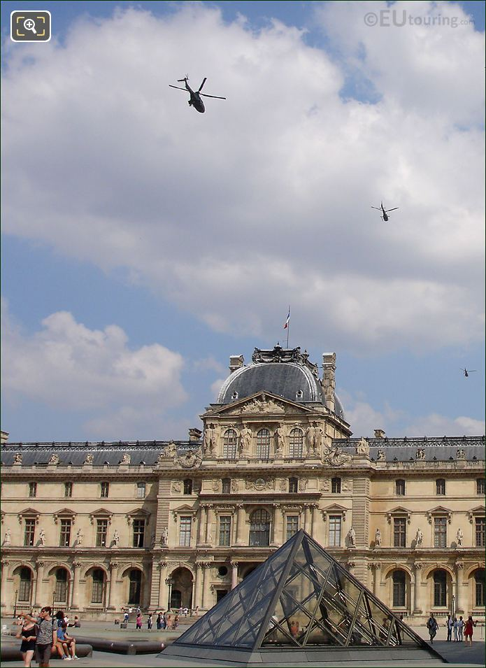 Helicopters Over Pavillon Sully At The Louvre