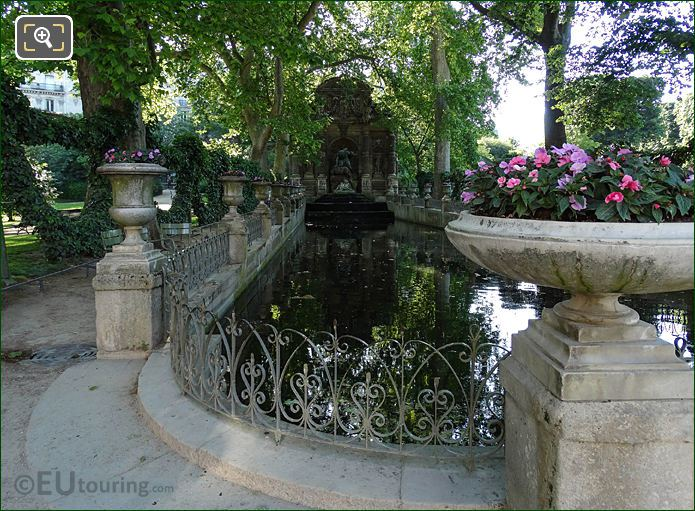 Stone Flower Pots And Metal Railings Around Fontaine Medicis
