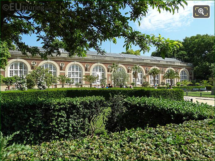 Hedges, Trees In Front Of Orangerie Building
