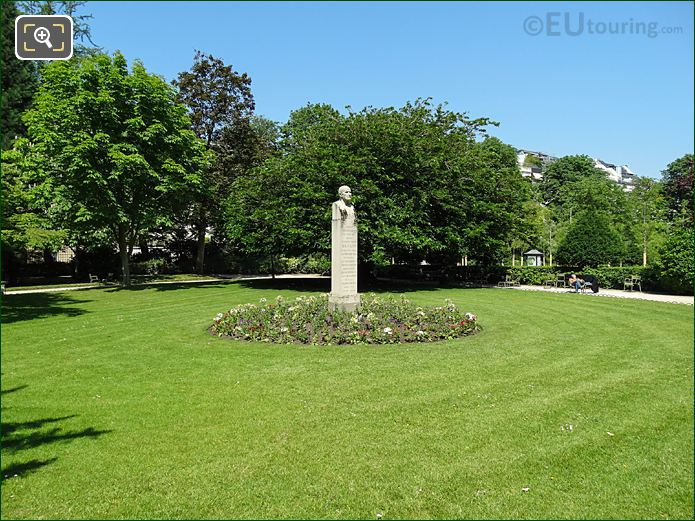 Monument With Flowerbed, Trees And Shrubs In Jardin Du Luxembourg