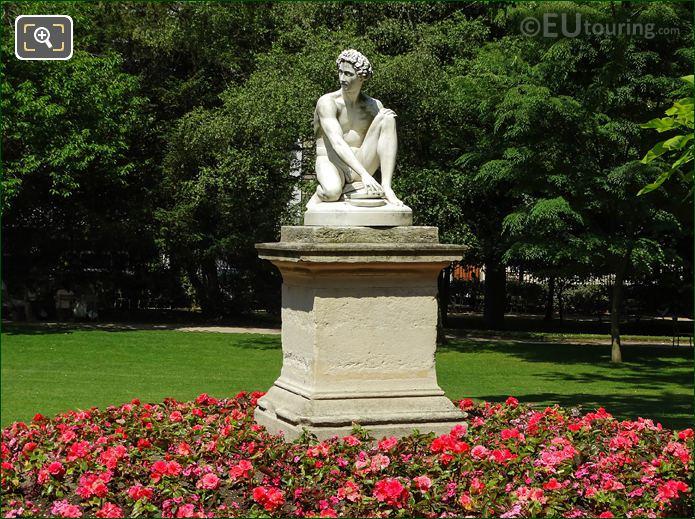 Red Flowers Around Archidamas Statue In Jardin Du Luxembourg