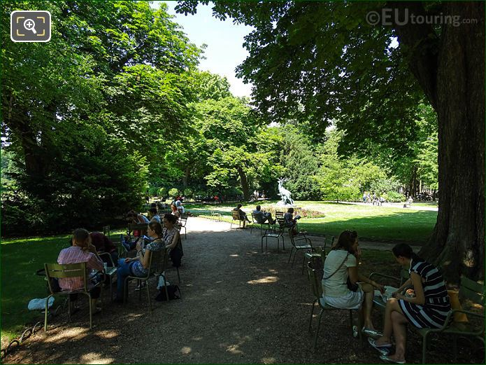 Tourists Relaxing On Green Chairs In Jardin Du Luxembourg