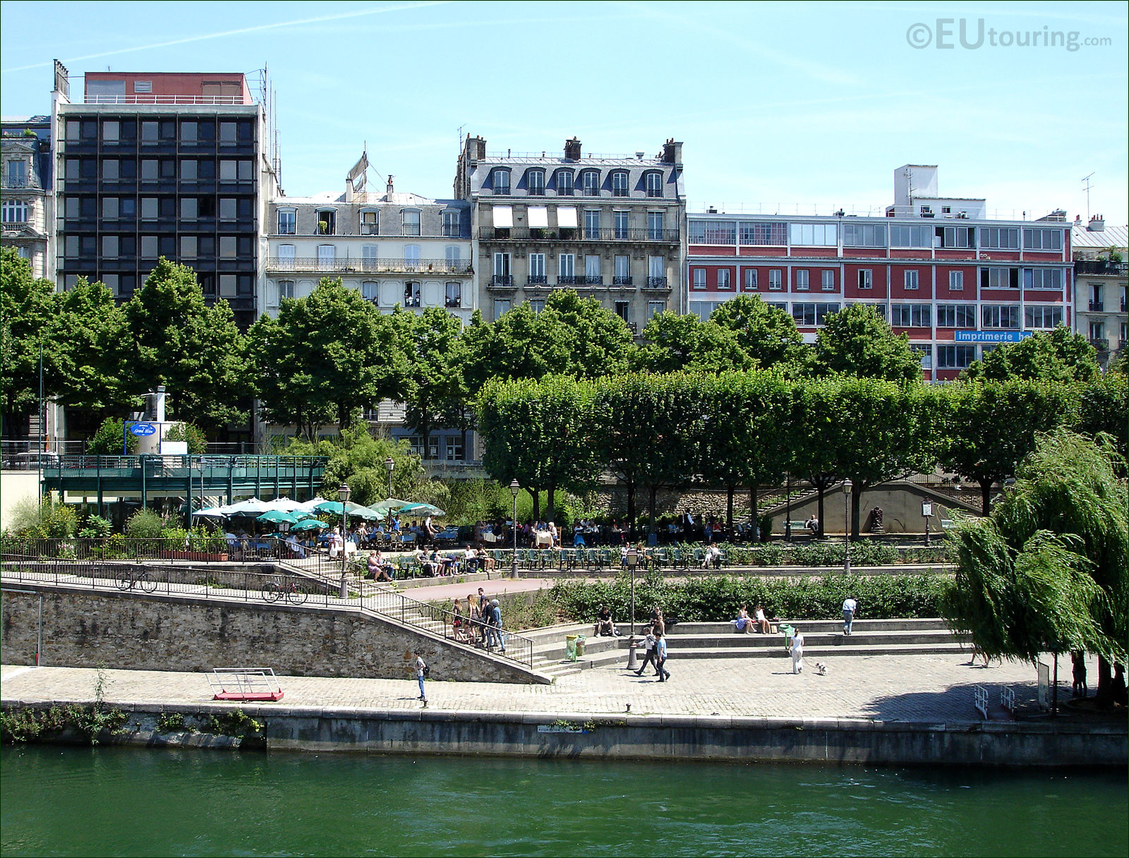 paris photo of canal saint martin with its restaurant. Black Bedroom Furniture Sets. Home Design Ideas