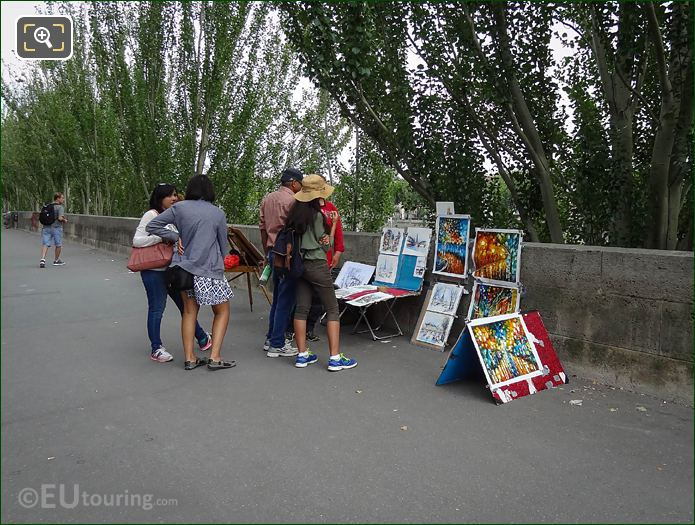 Paris Artist Selling Paintings To Tourists On Quai Francois Mitterrand