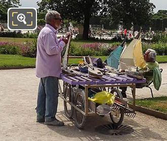 Vendor Repairing Model Sailing Boats In Tuileries Gardens