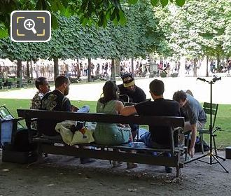 Group Having Music Session In Jardin Du Tuileries