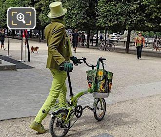 Gentleman Wearing Green Top Hat, Jacket, Glasses And Gloves In Tuileries Gardens