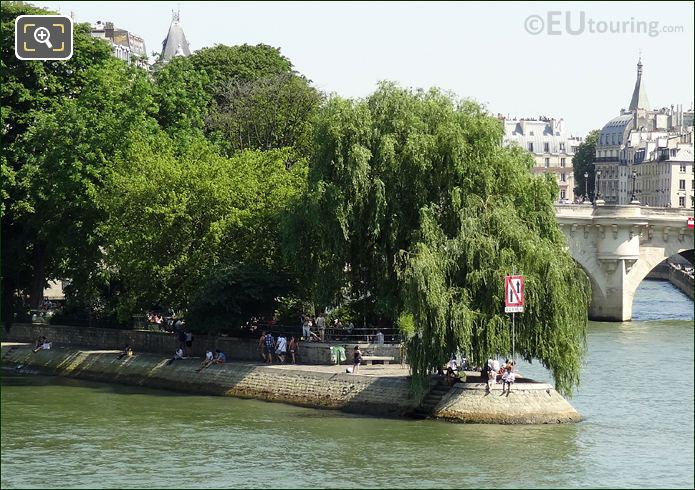 People Relaxing Along The River Seine