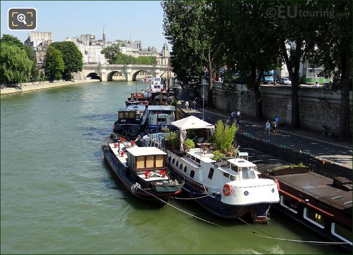 Houseboats Moored Along The River Seine
