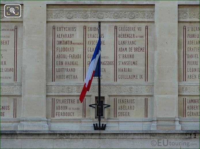 Inscriptions On La Bibliotheque Sainte-Genevieve With French Flag