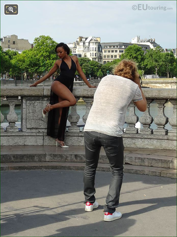 Photographer Taking Picture Of Glamour Model In Paris