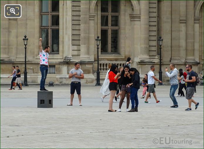 Tourists Taking Pictures On Platform In Cour Napoleon