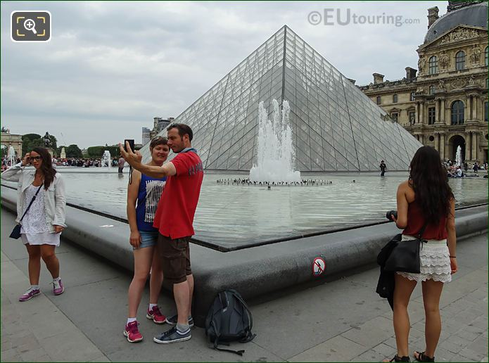 Couple Taking Selfie With Pyramid Musee Du Louvre