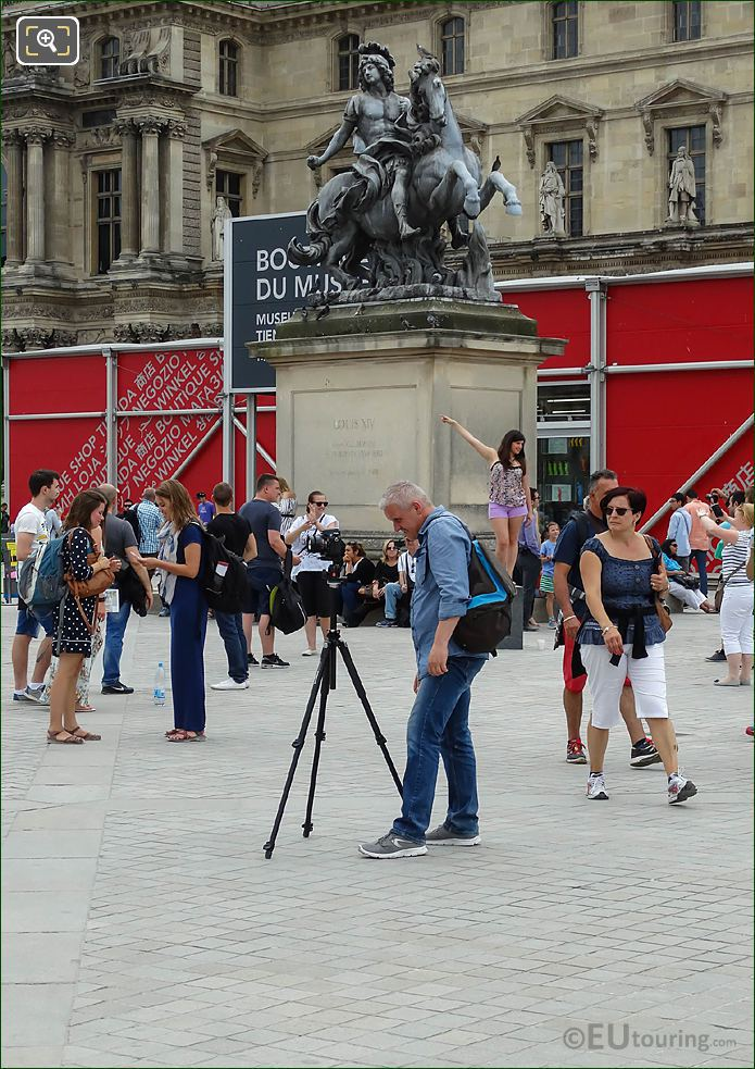 Photographer With Camera On Tripod Taking Pictures Of The Louvre