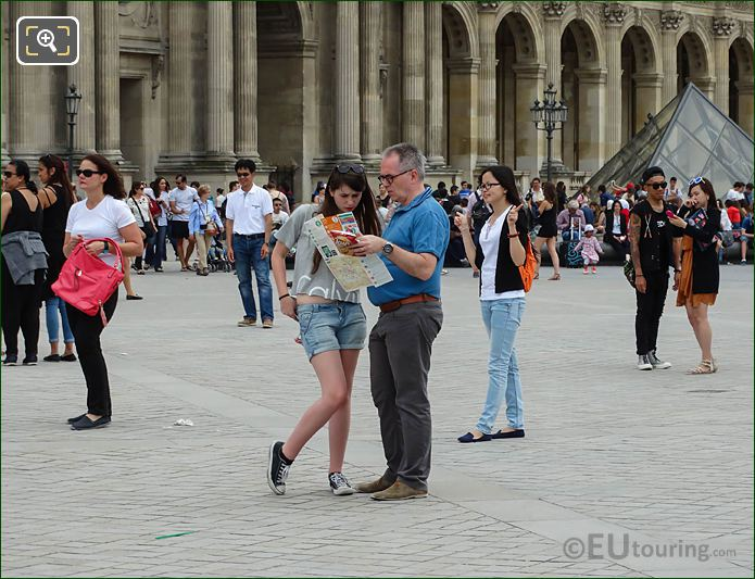 Tourists Map Reading In Cour Napoleon Courtyard Of The Louvre