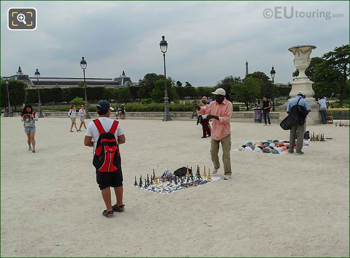 Street Sellers Selling Miniature Eiffel Towers At The Louvre