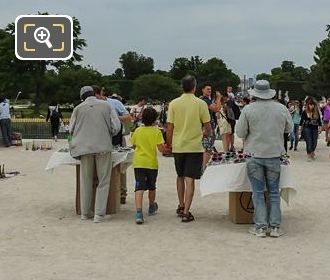 Street Sellers And Tourists At Steps Of Tuileries Garden