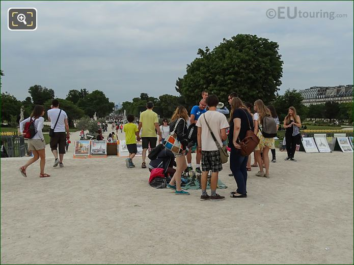 Tourist Buying From Street Sellers At Tuileries Garden Paris