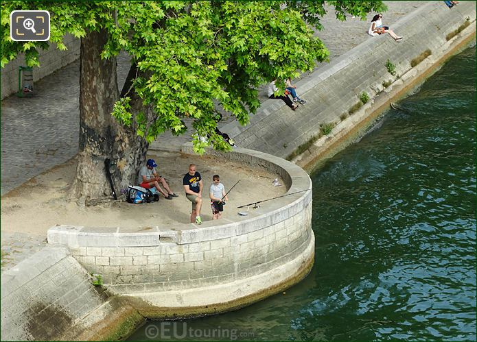 People Fishing The River Seine In Paris