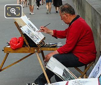 Artist Painting And Selling Paintings Along Quai Francois Mitterrand