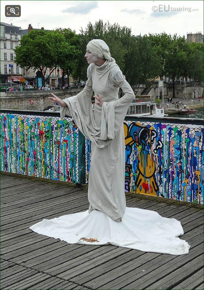 Human Statue On Pont Des Arts Bridge