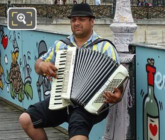 Musician Busking While Playing Accordion On Pont Des Arts