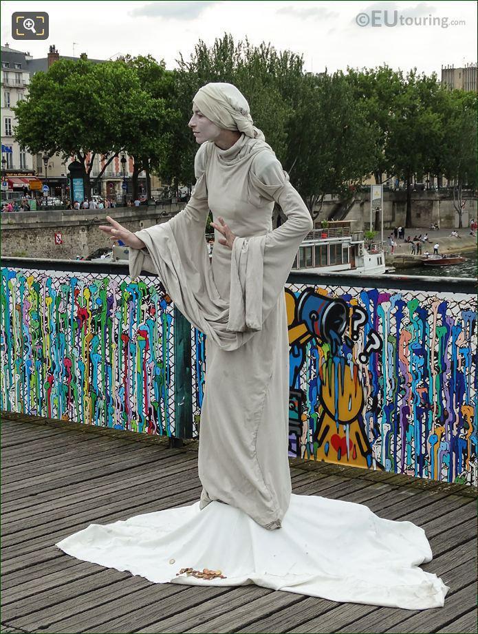 Human Statue On Bridge Of Love