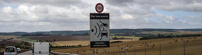 Speed camera sign along French road