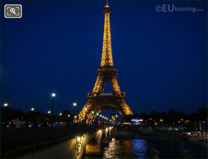 River Seine And The Eiffel Tower Lights On
