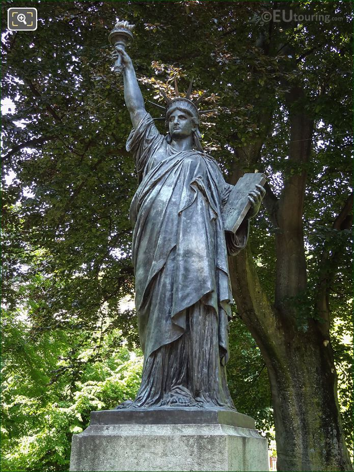 The Statue Of Liberty With American Oak Tree