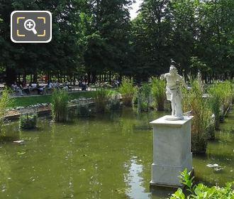 Apollo Statue On Pedestal In Pond Jardin Des Tuileries