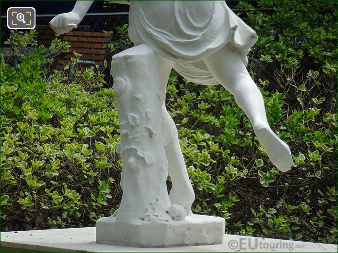 Sculpted Tree Stump On Atalante Statue