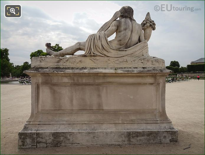 Back View Of Le Tibre Statue In Jardin Des Tuileries