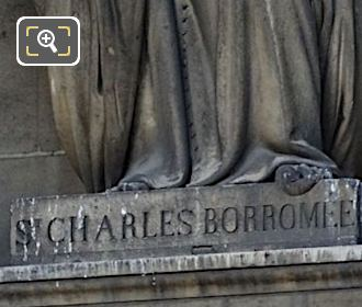 Inscription On Saint Charles De Borromee Statue