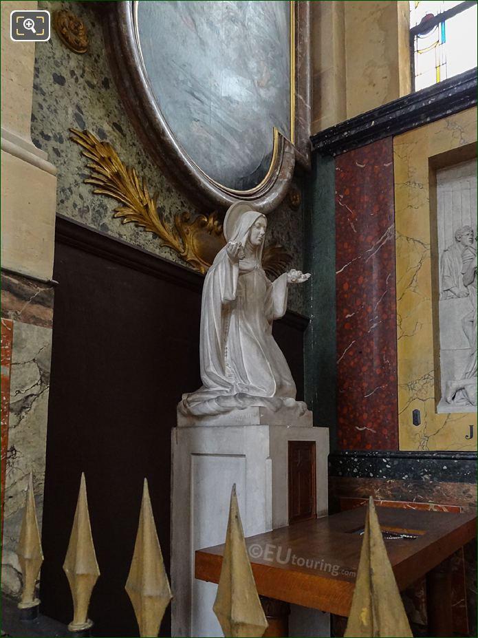 Saint Kneeling Statue Inside The Eglise Saint-Roch
