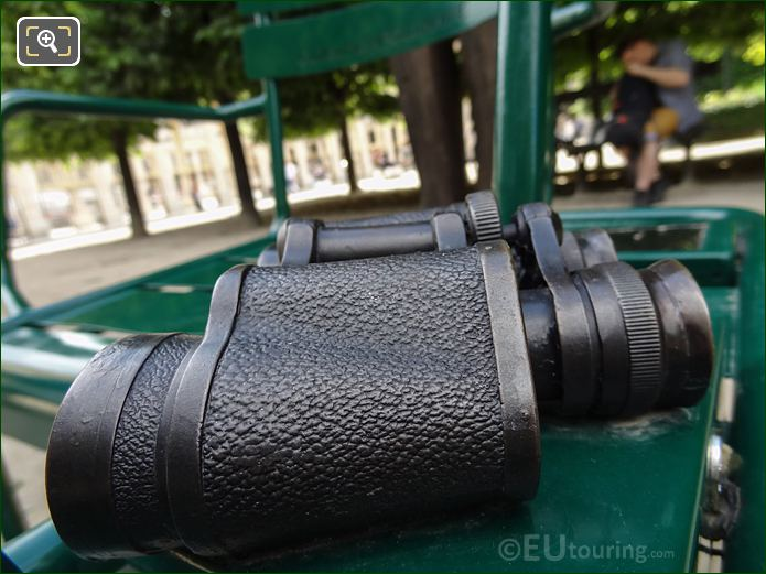 Side View Of Binoculars On Les Confidents Chairs