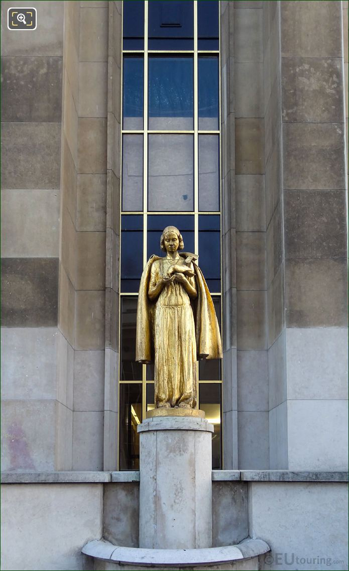 Golden Female Figure Holding Bird At Palais Chaillot