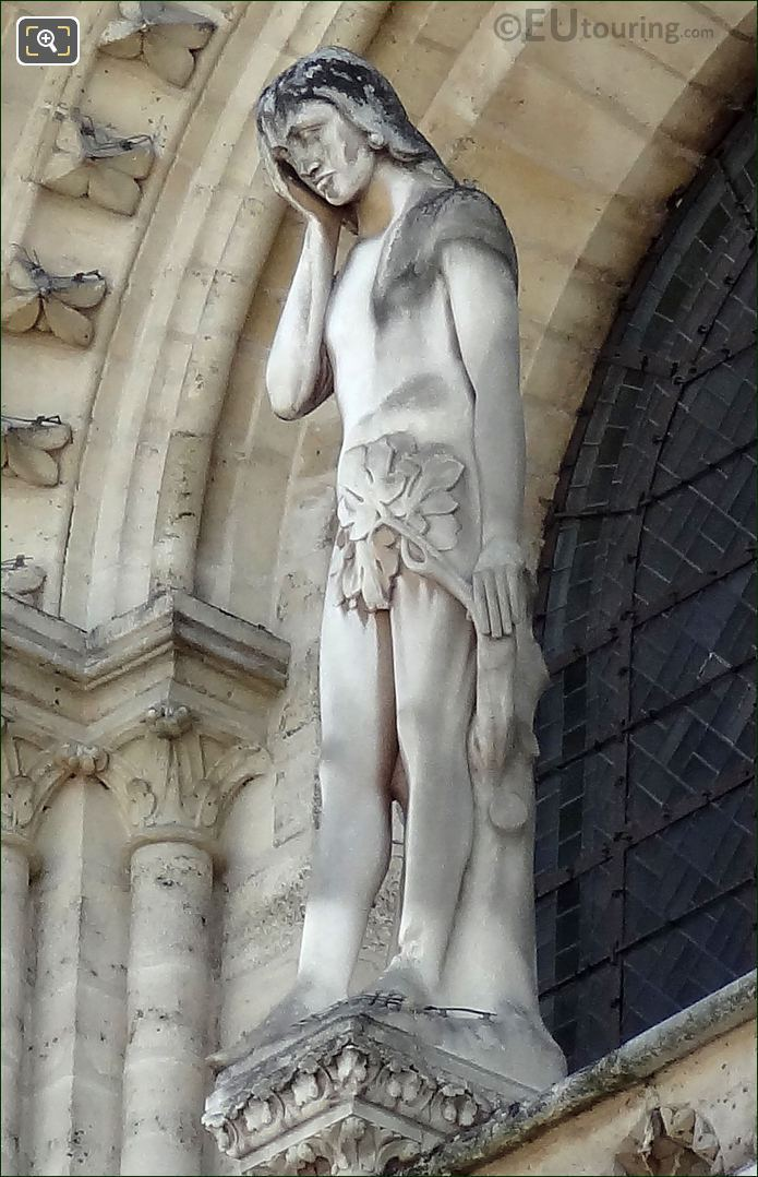 Statue Of Adam On Notre Dame Cathedral