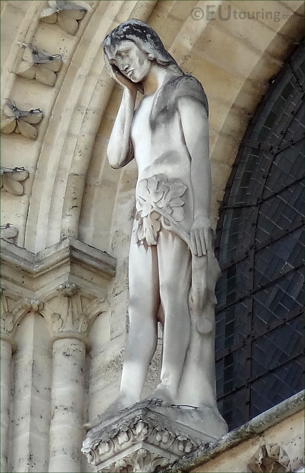 Photo of the statue of adam on notre dame cathedral in paris page 40