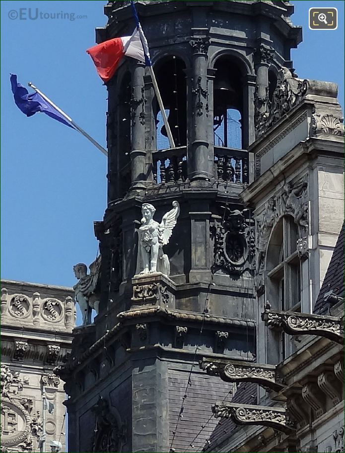 Winged Statue Next To Bell Tower On Hotel De Ville