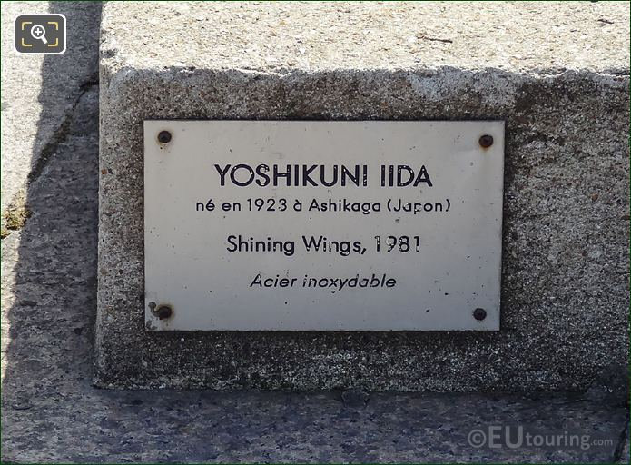 Plaque On The Shining Wings Sculpture