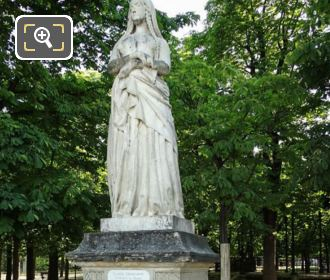 Statue Of Sainte Genevieve On Pedestal