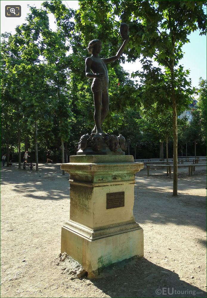 Le Marchand De Masques Statue On Pedestal