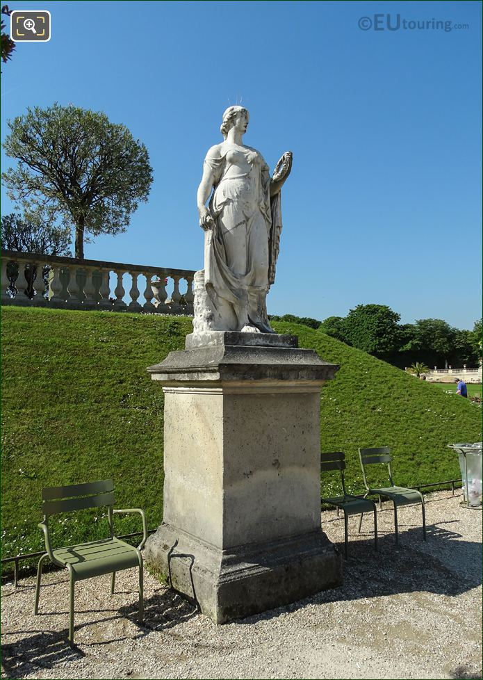 Flore Statue On Its Stone Base