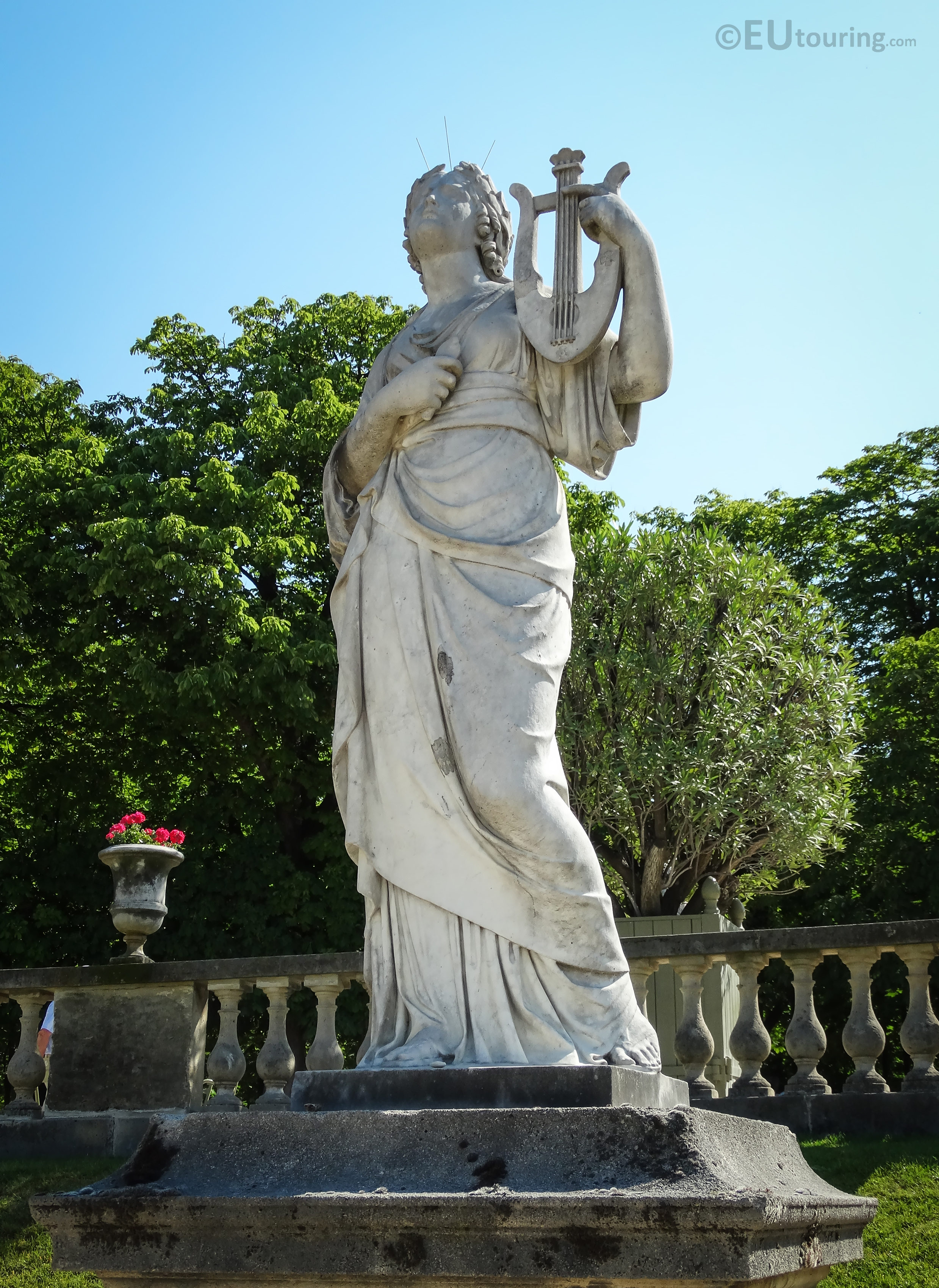 photos of goddess of music statue calliope in luxembourg